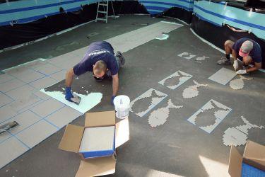 Fischförmige Mosaikbilder ausschneiden